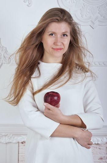 Looking At Camera Portrait One Person Long Hair Blond Hair Indoors  Smiling White Background Apple