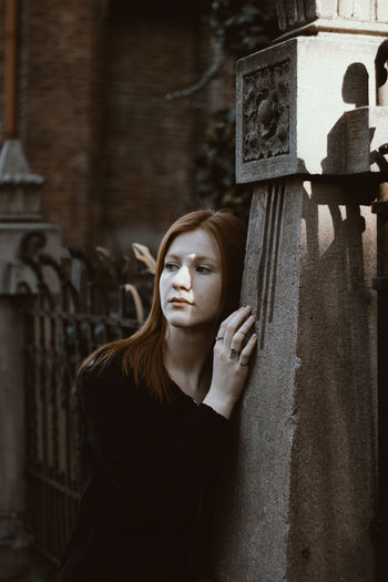 Gothic Red Adult Beautiful Woman Beauty Contemplation Depression - Sadness Emotion Front View Ginger Hairstyle Looking Mistic One Person Portrait Red Hair Religion Sadness Serious Spirituality Standing Waist Up Women Young Adult Young Women