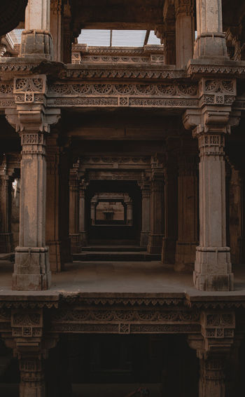 stepwell Architecture Built Structure The Past History Architectural Column No People Building Exterior Travel Destinations Building Craft Religion Low Angle View Spirituality Art And Craft Belief Carving - Craft Product Place Of Worship Travel Day Ornate Carving Adalajstepwell