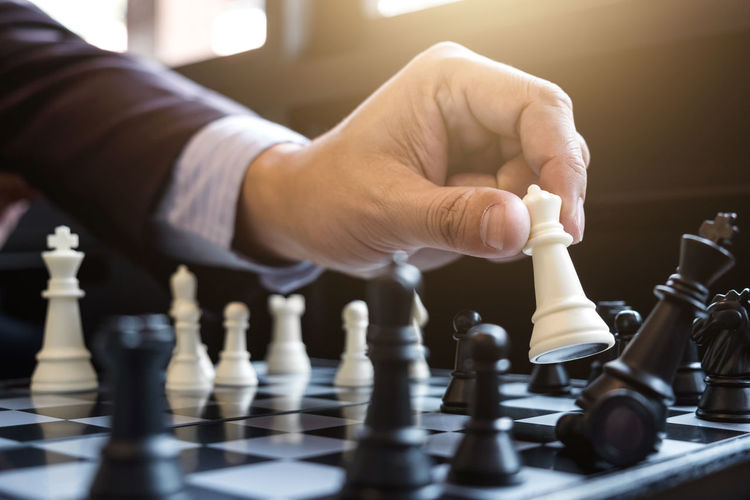 Cropped image of businessman playing chess
