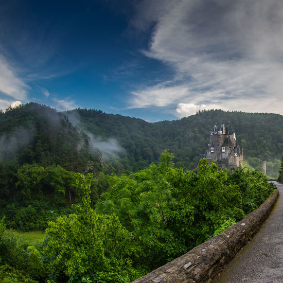 Eltz Castle / road view - galery edit / (c) Nidal Sadeq Castle Eltz Castle Fairytale  Architecture Beauty In Nature Building Exterior Built Structure Day Fantasy Photography Fine Art History Middle Ages Mountain Mountain Range Nature No People Outdoors Place Of Worship Robin Hood Scenics Sky Tranquility Travel Destinations Tree