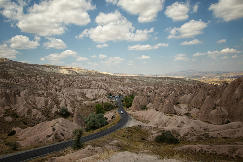 Cappadocia Cappadocia Cappadocia/Turkey Earth Rock Formation Turkey Arid Climate Beauty In Nature Cloud - Sky Environment Geological Formation Geological Landscape Landscape Mountain Mountain Range Nature Physical Geography Road Rock - Object Scenics - Nature Sky Tranquil Scene Tranquility Travel Destinations