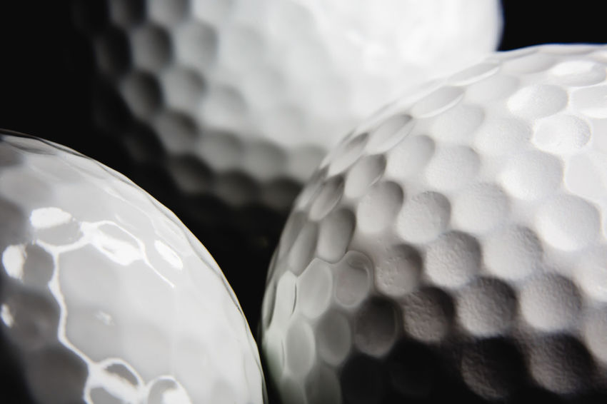 Golf ball on black background with copy space Golf Golf Course Golf Ball GolfBalls Golfing Rugged Ball Close-up Durable Equipment Game Golf Club Golfball Lasting Object Outdoors Play White
