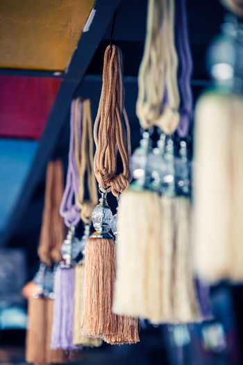 Close-up of clothes hanging on ceiling at market stall