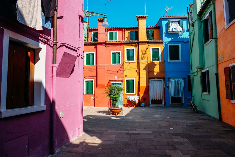 Colourful streets of Burano in Venice Italy Venice Venice, Italy Venice Italy Italy Color colour of life Colorful Europe Travel Travel Destinations City City Life Colourful Houses Streets Travel Photography Travelling Architecture Built Structure Building Exterior Building Residential District Day Nature Sunlight No People Window Multi Colored Outdoors Street Shadow Sky House Laundry Footpath Drying Alley Apartment