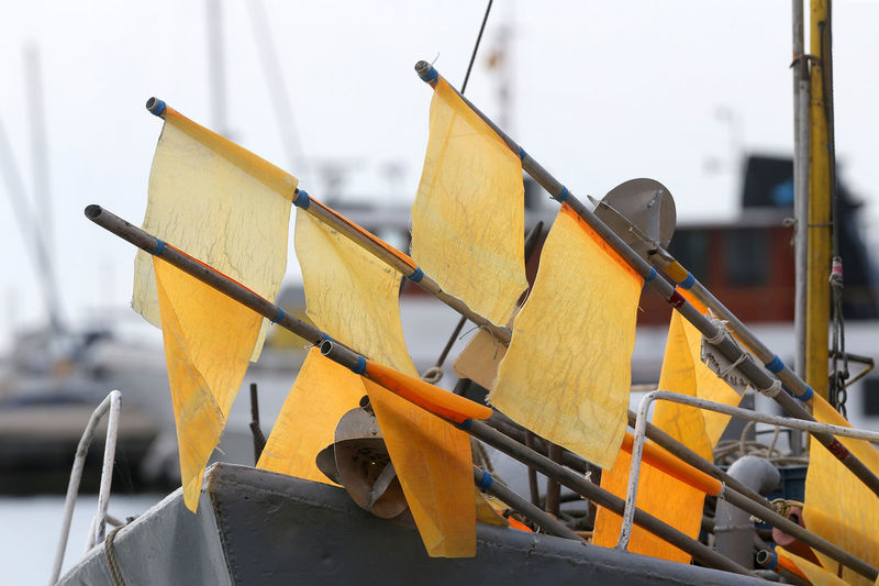 Close-up of yellow ship moored in water