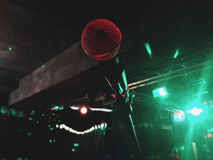 Man on illuminated stage