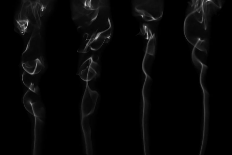 White smoke isolated on black background. Flow smoke or fog effect for montage. Studio Shot Black Background Smoke - Physical Structure Abstract Black Color Pattern Smoke Smoking Effect Particle Montage Firework Display Fog Sky White Color White Smog Light Dust Art Shape Close-up Motion Dark