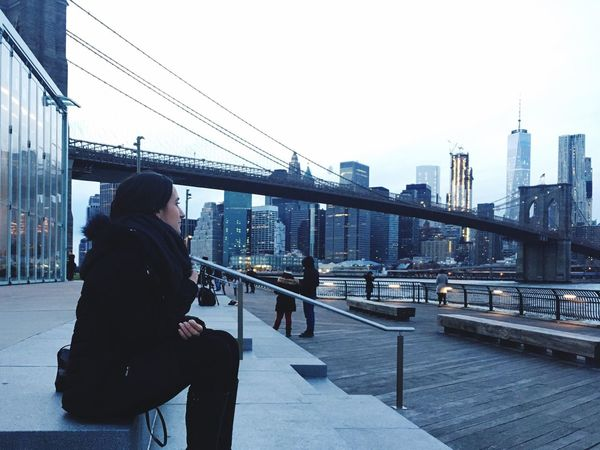 Architecture One Person Sky Built Structure Building Exterior Connection Outdoors Railing Clear Sky Day Brooklyn Brooklyn Bridge  New York Travel Destinations Bridge - Man Made Structure Suspension Bridge City Cityscape Water People Young Adult Adults Only Adult