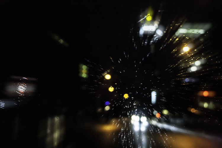 Car Lights Motion Blur Rain RainDrop Water Reflections Architecture Blurred Motion Bokeh Bokeh Photography Car Car Window City Drop Illuminated Light Motion Night No People Outdoors Rain On Car Rain On Car Window Rain On Window Street Water Windshield