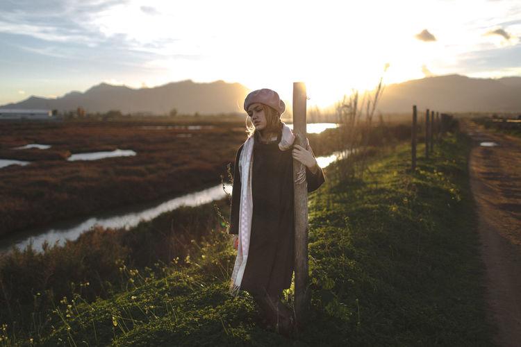 Teenage girl standing on grassy field