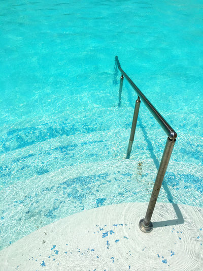 Swimming pool against blue water