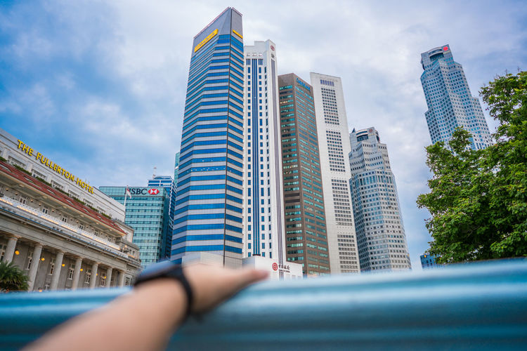 business view through my hand Architecture Building Exterior Built Structure Business Finance And Industry Businessman City Cityscape Day Human Body Part Human Hand Modern One Person Outdoors Real People Sky Skyscraper Sucess Tall - High Urban Skyline