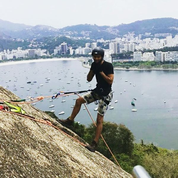 Rapel morro da urca. Sport One Man Only Only Men Water One Person Adult Men Adults Only Casual Clothing Exercising Mountain People Full Length Day Outdoors Standing City Athlete Golf Club Sportsman