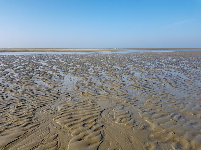 Rippled Beach Water Low Tide Sea Beach Clear Sky Sand Blue Rippled Tide Coastal Feature Coastline Seascape Coast