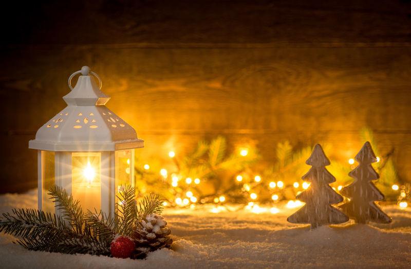Illuminated christmas lights in snow