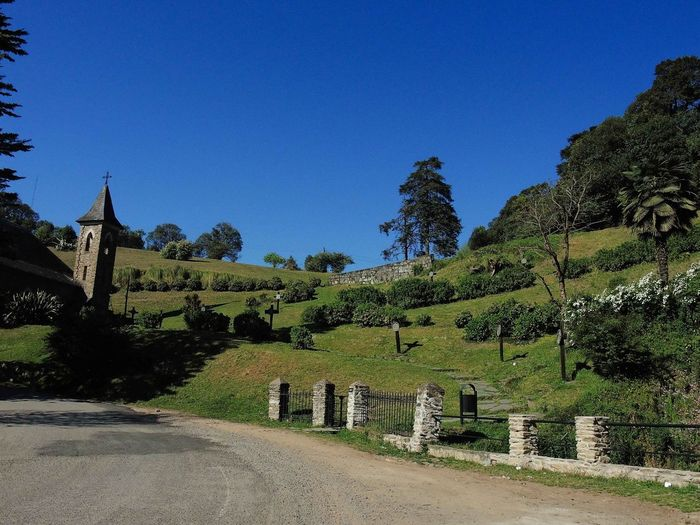 Landscape near to Yerba Buena, Tucumán, Argentina. 2016/09/15. Architecture Blue Church Clear Sky Countryside Curve Day Diminishing Perspective Empty Road Footpath History No People Outdoors Plant Road Scenics Solitude The Way Forward Tourism Tranquil Scene Tranquility Travel Destinations Tree