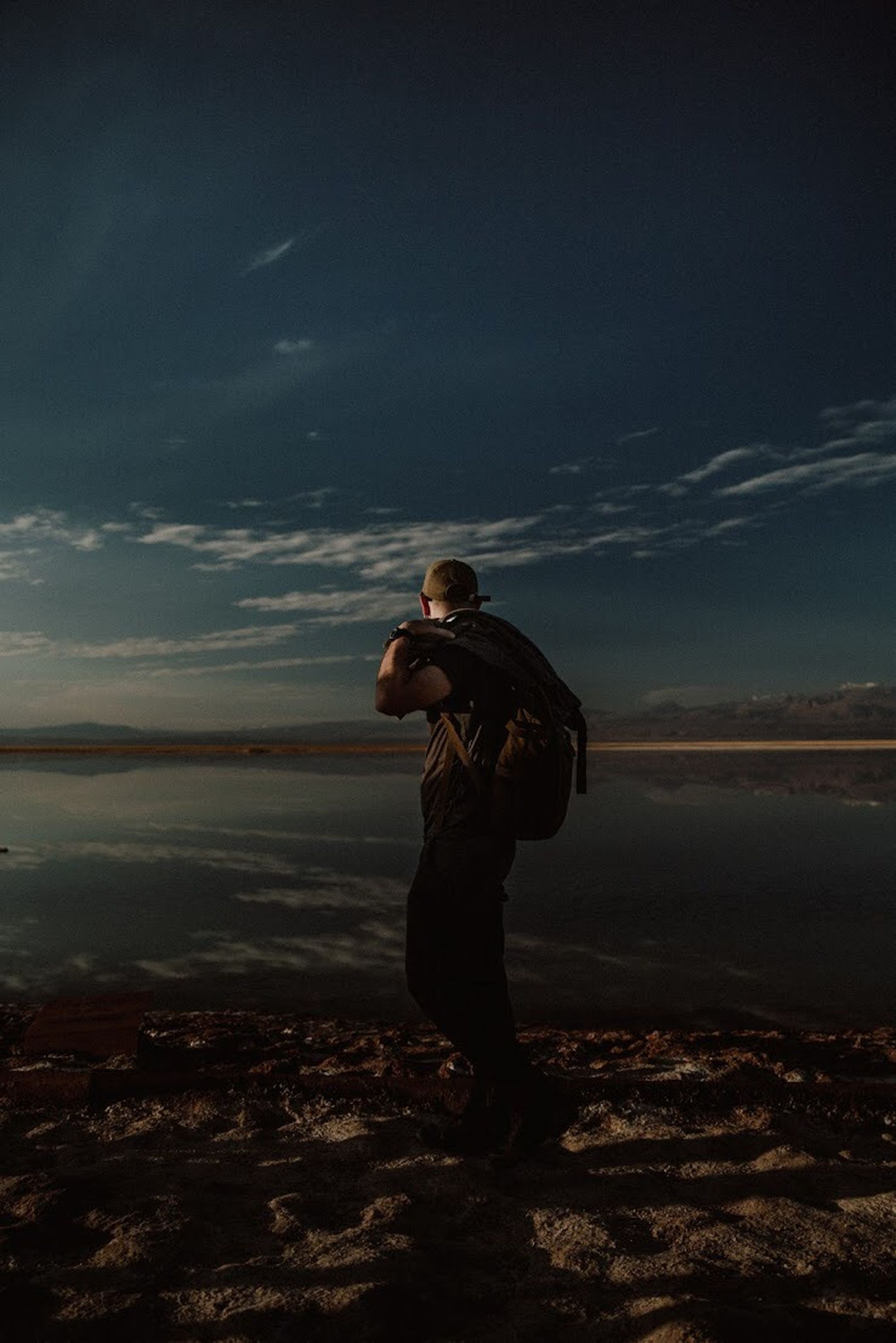 one person, full length, sky, standing, real people, lifestyles, nature, leisure activity, cloud - sky, land, beauty in nature, scenics - nature, side view, casual clothing, tranquil scene, tranquility, young adult, non-urban scene, outdoors, teenager