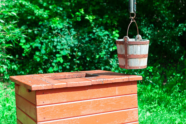 Well with wooden bucket . drinking water source