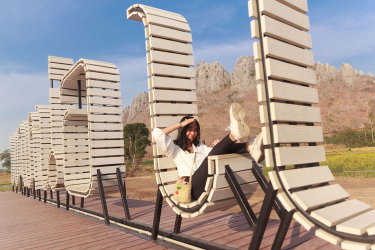Woman sitting on chair outdoors