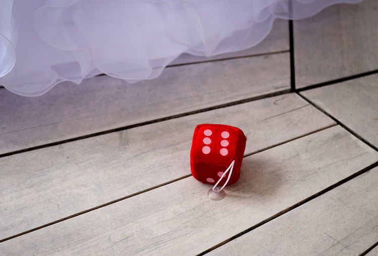 Close-up of dice on wooden floor