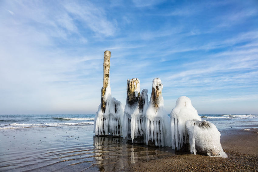 Winter time on the Baltic Sea coast. Baltic Sea Beach Clouds And Sky Coast Day Frozen Groyne Holiday Ice Kuehlungborn Kühlungsborn Landscape Nature No People Outdoors Shore Sky Sky And Clouds Tourism Travel Vacations Water Winter