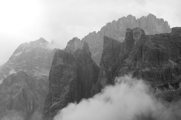 black and white Beauty In Nature Day Environment Eroded Fog Formation Geology Landscape Mountain Mountain Peak Mountain Range Nature No People Non-urban Scene Outdoors Rock Rock - Object Rock Formation Scenics - Nature Sky Solid Tranquil Scene Tranquility