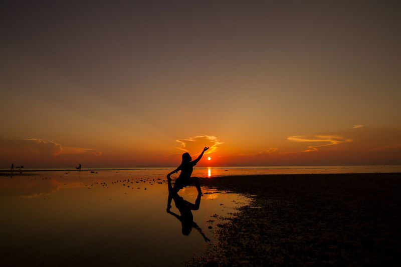 Beach Beauty In Nature Day Full Length Horizon Over Water Leisure Activity Lifestyles Men Nature One Person Outdoors People Real People Scenics Sea Silhouette Sky Sunset Tranquility Water