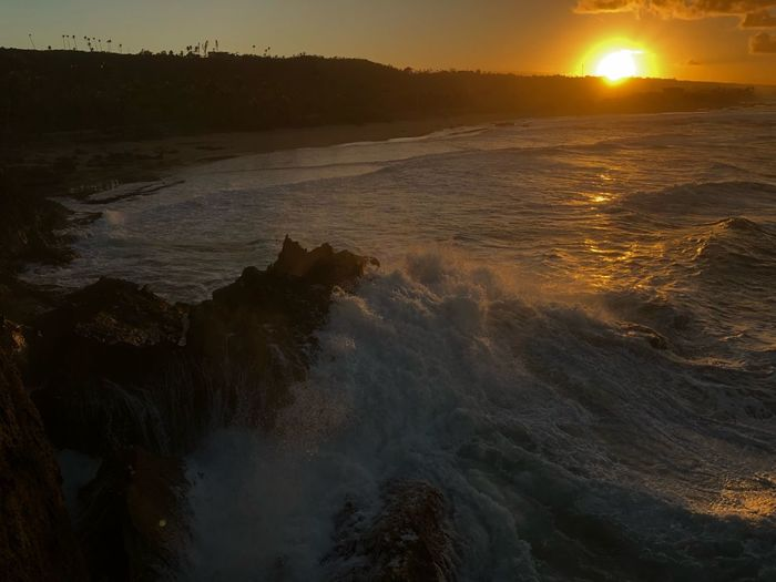 Wavy setsunning Puertoricotourism Puertorico Sunset Nature Beauty In Nature Water Sun Sea Wave Tranquil Scene Scenics Tranquility No People Outdoors Beach Sky