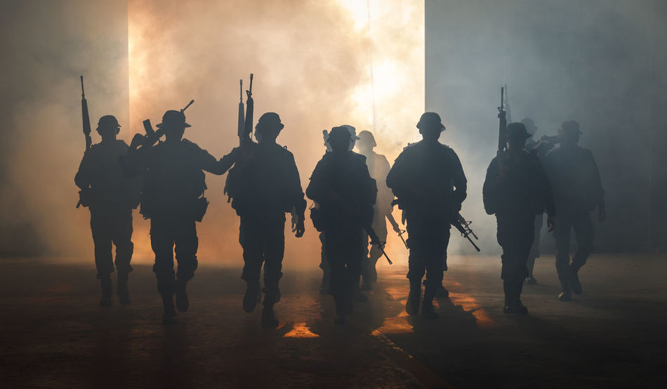 Teamwork Crowd Full Length Government Group Group Of People Gun Control Medium Group Of People Men Nature People Real People Silhouette Smoke - Physical Structure Soldiers Uniform Standing Sunset Togetherness Uniform