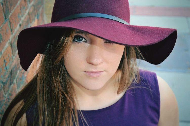 Portrait of beautiful woman wearing hat