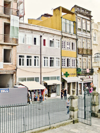 Oporto, Portugal Architecture Building Building Exterior Built Structure City City Life Day Group Of People Incidental People Men Mode Of Transportation Nature Outdoors People Railing Real People Residential District Street Transportation Window