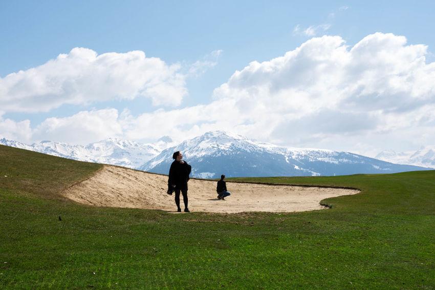 Two People Full Length Landscape Mountain Outdoors Beauty In Nature Day Nature Green Color Bunker Golf Switzerland EyeEm Switzerland Alps EyeEm Best Shots Little Human Portrait Of A Friend