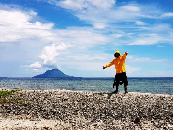 A survivor One Man Only Cloud - Sky Nature Sky Mountain Beach Clouds And Sky Island Yellow Color Day Diver
