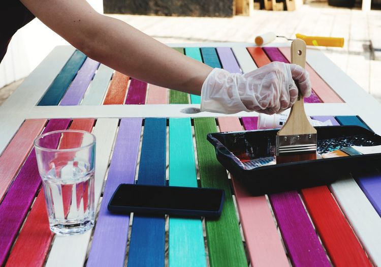 Close-Up Of Person Painting Table
