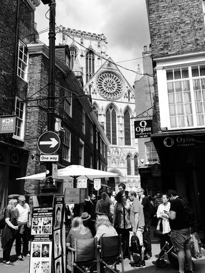 First view of York Minster and what an imposing sight! Colour Your Horizn Building Exterior Architecture Built Structure City Street City Life Real People Outdoors Women Men Day Crowd Sky York York Minster  Minster Streetphoto_bw Black And White The Week On EyeEm Stories From The City Adventures In The City Adventures In The City