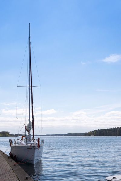 Nautical Vessel Transportation Mode Of Transport Sky Water Sea Cloud - Sky Boat Nature Outdoors Day Moored Tranquility Sailboat Scenics Beauty In Nature Sailing Mast Men People