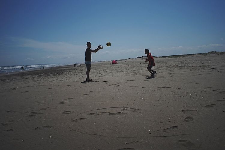 EyeEm Beach Sand Playing Full Length Boys Fun Leisure Activity Childhood Ball Vacations Child Sky Day Standing Outdoors Soccer Sea People Nature Adult Silhouette_collection Nature Landscape Light And Shadow