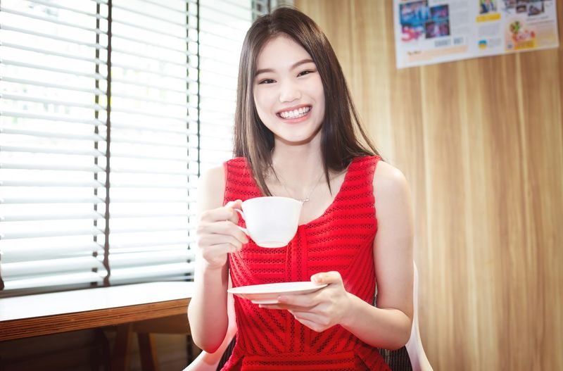 Young woman drinking coffee cup