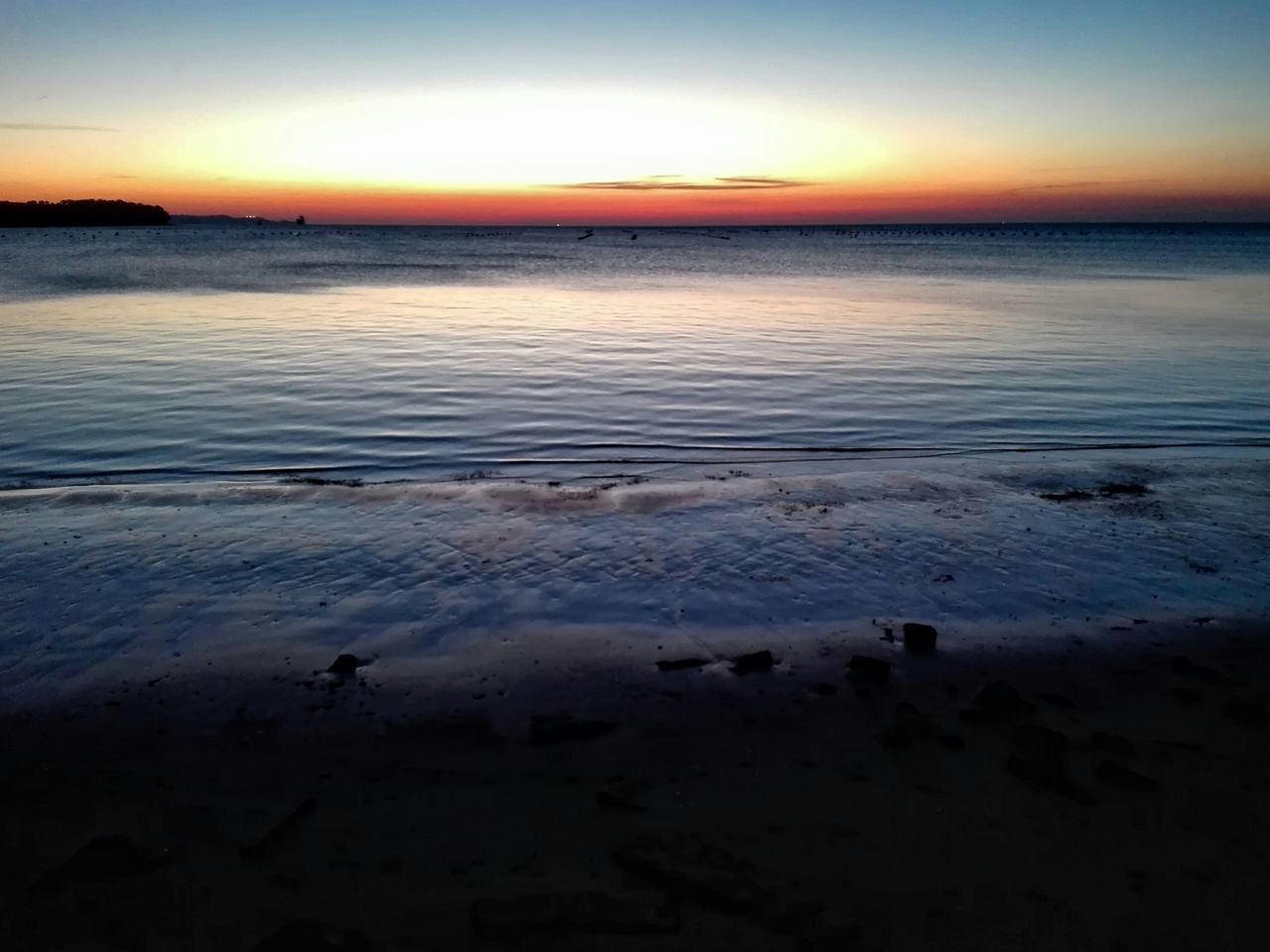 sunset, nature, beauty in nature, beach, sea, tranquility, scenics, tranquil scene, water, sky, outdoors, sun, sand, horizon over water, dusk, no people, silhouette, winter, wave, landscape, clear sky, low tide, day