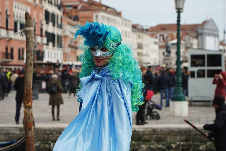 Woman wearing mask and costume during carnival in city