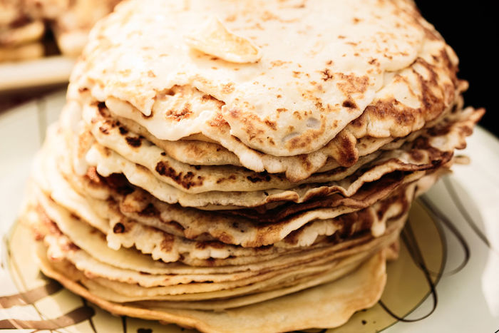 A stack of pancakes - traditional, folk meal of the eastern Slavs. Maslenitsa Belarus Dish Food And Drink Gomel National Tradition View Close-up Culture Ethnic Folk Food Food And Drink Horizon Over Water Maslenitsa No People Nobody Pankakes Pile Plate Ready-to-eat Russian Shrovetide Stack Traditional