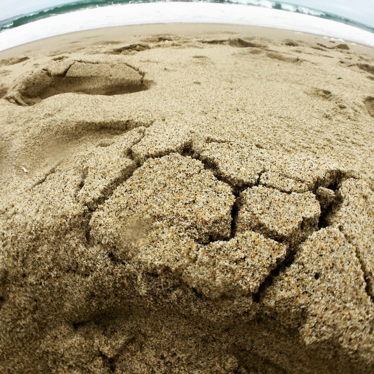 sand, nature, no people, beach, day, outdoors, fish-eye lens, tire, close-up, water, sky