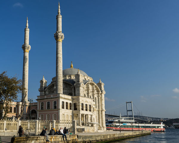 Istanbul Ortaköy Architecture Blue Building Exterior Built Structure Clear Sky Day Dome History Mecidiyecami Ortaköy Mosque Outdoors Place Of Worship Real People Religion Sky Spirituality Tourism Travel Travel Destinations Adventures In The City