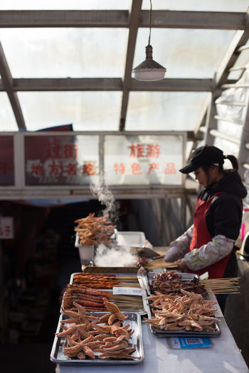 Barbeque Time Exotic Hungry Seafood Travel Baked Barbeque Exotic Food Food Food And Drink Fresh Seafood Freshness Indulgence Local Food Occupation Small Business Squid Starfish  Street Food Streetfood Worldwide Train Station Weird Food Women Working Yummy Food Stories