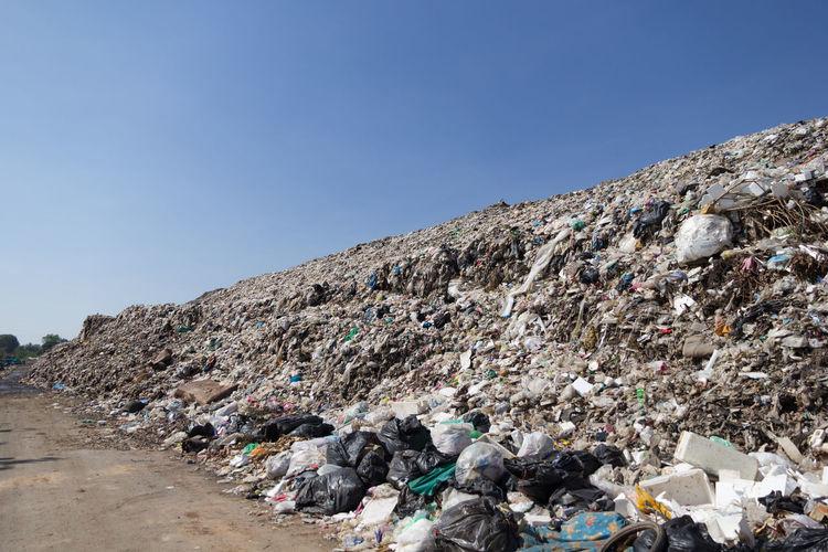 Garbage Against Blue Sky