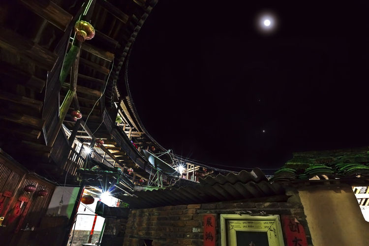 Tulou Tulou is the most extraordinary type of Chinese rural dwellings of the Hakka and others in the mountainous areas in southeastern Fujian, China. HUAWEI Photo Award: After Dark Moon Architecture Building Building Exterior Built Structure Hakka Illuminated Lighting Equipment Low Angle View Moon Nature Night Night View No People Outdoors Rural Dwellings Sky Tulou