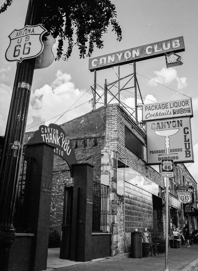 Americana Architecture Arizona Bar Bars And Clubs Black And White Blackandwhite D Day Low Angle View Mamiya Medium Format No People Outdoors Road Sign Route 66 Sidewalk Sign Sky Small Town Southwest USA Urban Exploration Vintage Williams, Arizona