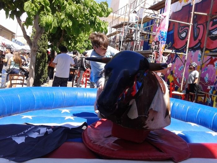 Bored Boys On Mechanical Bull Bucking Bronco Falling Off Mechanical Bull Mechanical Bull  Mechanical Bull Boys Mechanical Bull Funny Street Festival Cypru Street Festival Graffiti