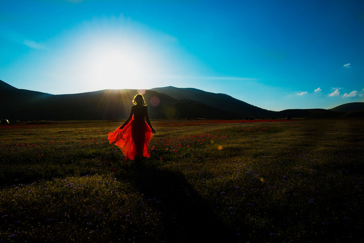 Adult Beauty In Nature Clothing Field Full Length Land Leisure Activity Lens Flare Lifestyles Mountain Nature One Person Outdoors Real People Scenics - Nature Sky Standing Sunlight Tranquil Scene Tranquility Women